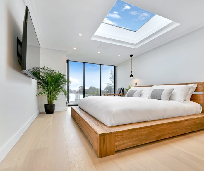 bedroom with large windows in Hip to Gable & Dormer loft conversion, at a house in Hither Green South East London SE12.