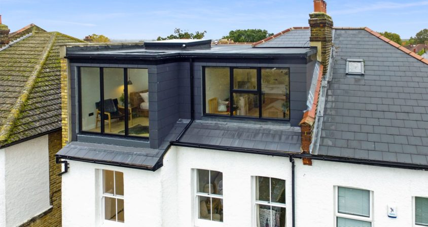 Hip to Gable Loft Conversion exterior with grey slating in Hither Green, South East London SE12