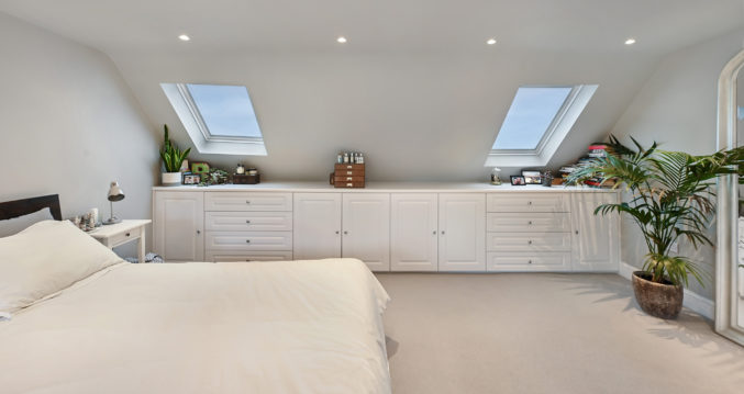white built-in cupboards, part of an L-shaped Dormer loft conversion, in Hither Green South East London, SE6